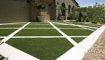 image of custom driveway design artificial turf installation