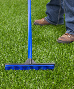 image of brushing artificial grass